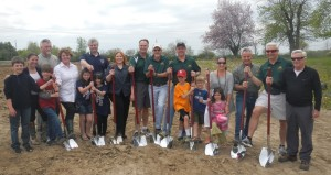 A group of people holding shovels